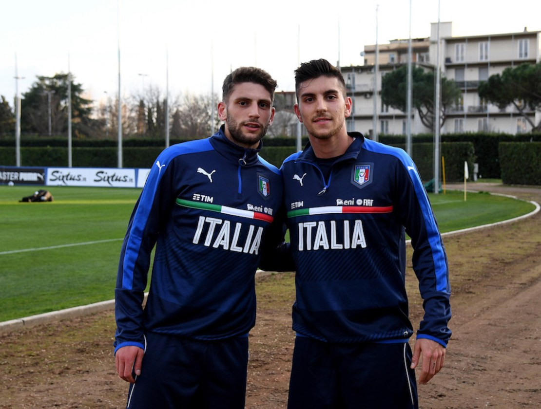 FLORENCE, ITALY - FEBRUARY 21: Domenico Berardi (L) and Lorenzo Pellegrini of Italy pose for a photo prior to the official portrait session at Coverciano on February 21, 2017 in Florence, Italy. (Photo by Claudio Villa/Getty Images)