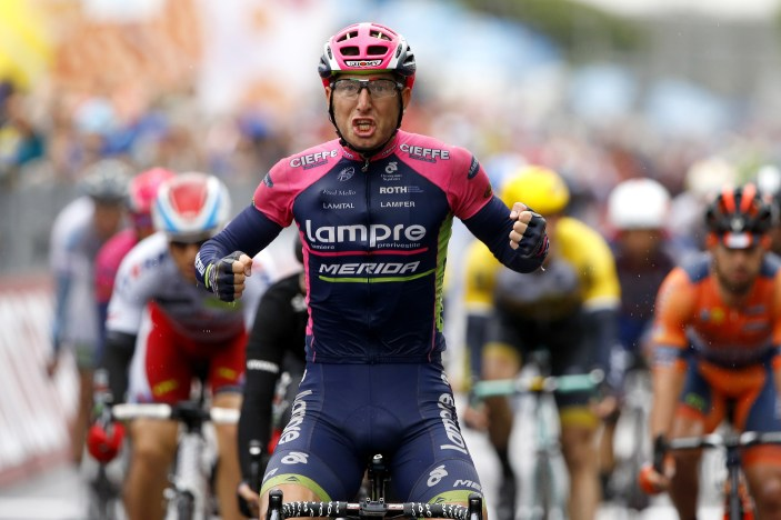 Italian rider Sacha Modolo (Lampre Merida) celebrates as he crosses the finish line to win the 13th stage of the 98th Giro d'Italia, Tour of Italy, cycling race between Montecchio Maggiore and Jesolo on May 22, 2015 in Jesolo. AFP PHOTO / LUK BENIES (Photo credit should read LUK BENIES/AFP/Getty Images)