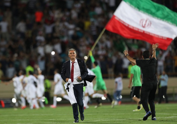 TEHRAN, IRAN - JUNE 12: Head coach Carols Quieroz and players of Iran celebrate after the match during FIFA 2018 World Cup Qualifier match between Iran and Uzbekistan at Azadi Stadium on June 12, 2017 in Tehran, Iran. (Photo by Amin M. Jamali/Getty Images)