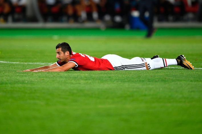 Manchester United's Armenian midfielder Henrikh Mkhitaryan lies on the lawn during the UEFA Super Cup football match between Real Madrid and Manchester United on August 8, 2017, at the Philip II Arena in Skopje. / AFP PHOTO / Dimitar DILKOFF (Photo credit should read DIMITAR DILKOFF/AFP/Getty Images)