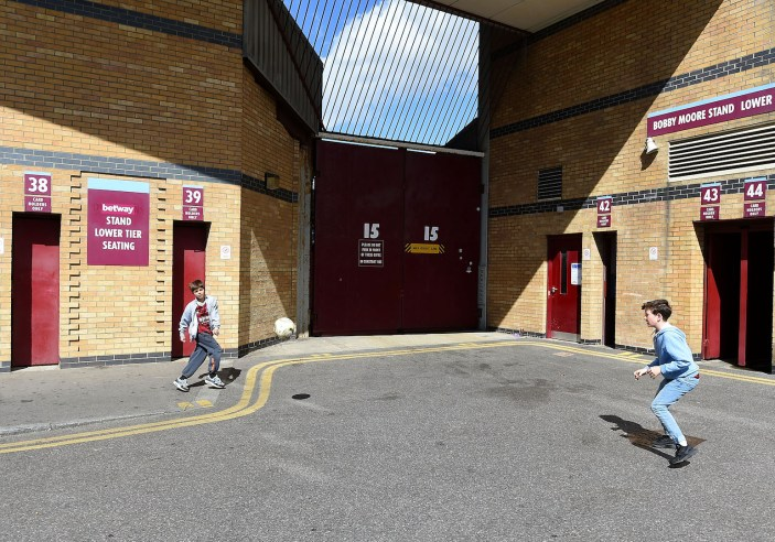 LONDON, ENGLAND - APRIL 11: Boys play football outside the stadium prior to the Barclays Premier League match between West Ham United and Stoke City at Boleyn Ground on April 11, 2015 in London, England. (Photo by Tom Dulat/Getty Images)