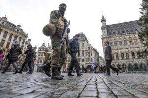 Belgian soldiers patrol on Brussels Grand Place after security was tightened in Belgium following the fatal attacks in Paris