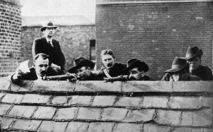Some Irish rebels lying in wait on a roof getting ready to fire during the Easter Rising. Ireland, 1916 (Photo by Mondadori Portfolio via Getty Images)