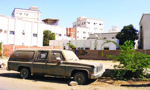 Abandoned cars like this are a common sight in many Jeddah neighborhoods.