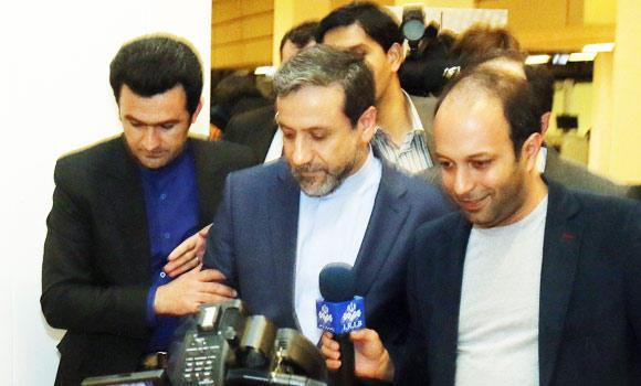 Iran's deputy Foreign Minister Abbas Araghchi, center, arrives for an Iranian press briefing at the International Center Vienna, Austria, on Friday. (AP)