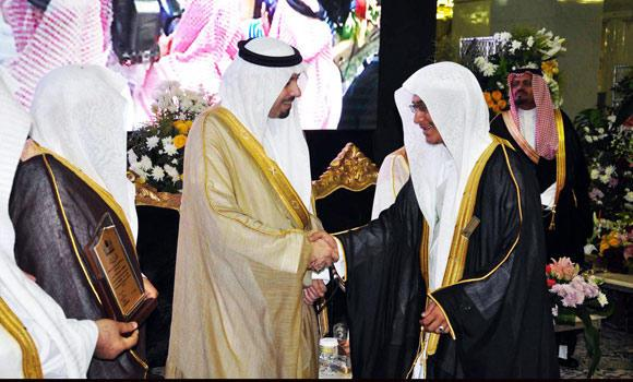 Makkah Gov. Prince Mishaal bin Abdullah congratulates a graduate of the Grand Mosque Institute in Makkah on Thursday