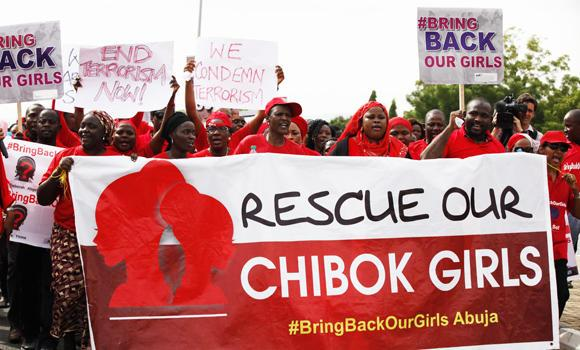 People attend a demonstration calling on the government to rescue the kidnapped girls of the government secondary school in Chibok village of Abuja, Nigeria, on May 22, 2014. Many schools across the country closed to protest the abductions of more than 300 schoolgirls by Boko Haram, the government's failure to rescue them and the killings of scores of teachers by extremists in recent years. (AP Photo/Sunday Alamba)