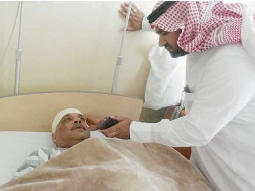 The Saudi who was injured while asleep when a car crashed into his house in Al-Wajh, Tabuk, speaks to a reporter from his hospital bed.