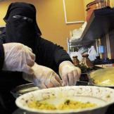 A veiled Saudi woman works at a restaurant in Tabuk, 1500 km from Riyadh, in this November 30, 2013 file photo.