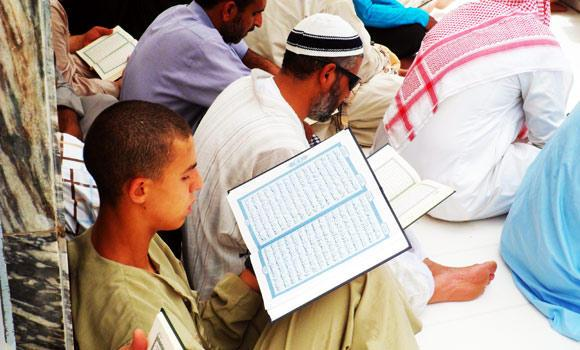 A-young-man-reads-holy-Quran-in-Makkah-masjid