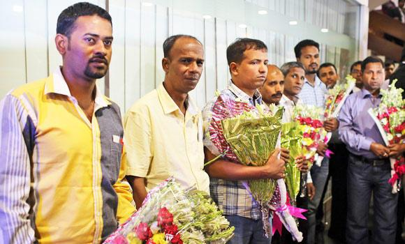 Bangladeshi released sailors pose for a group photograph at Hazrat Shahjalal International Airports in Dhaka, Bangladesh, on Thursday.