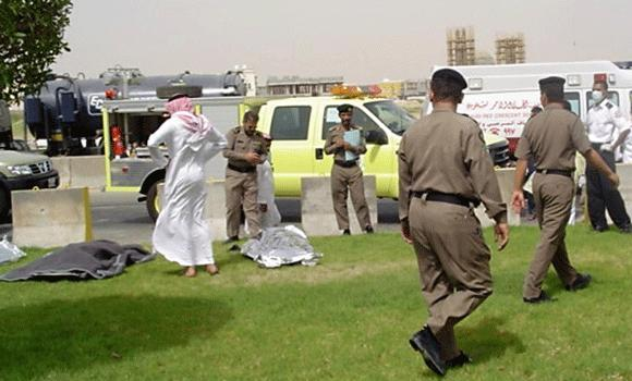 In this May 29, 2004 file photo, covered bodies lie on the ground as Saudi police inspect the scene in front of the Petroleum Center, one of the sites of triple attacks targeting oil facilities by suspected militants, in the eastern oil city of al-Khobar.
