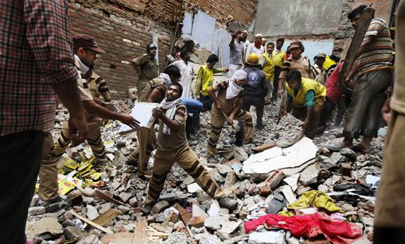 Rescue workers clear debris at the site of a building collapse in New Delhi, India, one of two buildings that collapsed in India on Saturday. On Sunday, police arrested officials of a construction company responsible for the second building that collapsed in Chennai, Tamil Nadu.