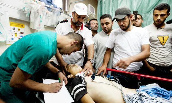 Medics check the body of Mohammed Dodeen,15, at a hospital in the West Bank city of Hebron, on Friday.