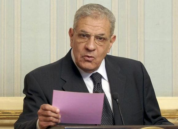 Egypt's new Prime Minister Ibrahim Mahlab talks during a news conference at the presidential palace in Cairo, March 2, 2014.