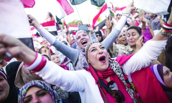 Egyptians celebrate in front of the presidential palace in Cairo after ex-army chief Abdel Fattah El-Sissi won 96.9 percent of votes in the presidential election. (AFP)