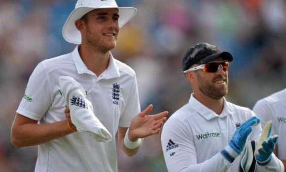 England's Stuart Broad, left, leaves the field walking with Matt Prior after taking a hat trick during the first innings on the first day of the second cricket Test match between England and Sri Lanka at Headingley in Leeds, northern England on Friday.