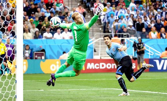 England's goalkeeper Joe Hart can't stop Uruguay's Luis Suarez's header.
