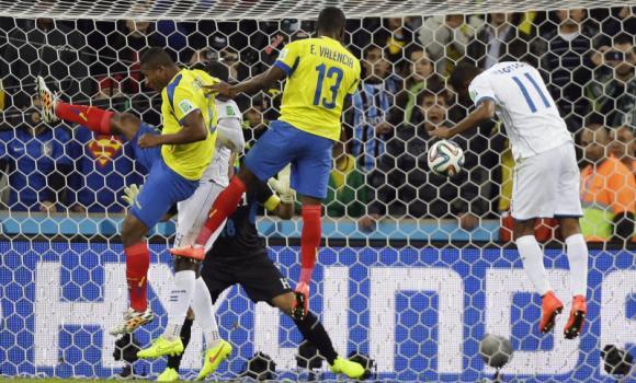 Enner Valencia (13) scores Ecuador's second goal with a header during the group E World Cup soccer match between Honduras and Ecuador at the Arena da Baixada in Curitiba, Brazil, on Friday