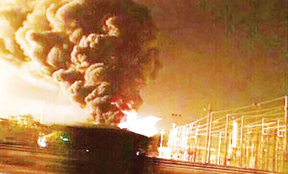 A plume of smoke rises from the area hit by a fire at Saudi Aramco's Berri Gas Plant in Jubail.