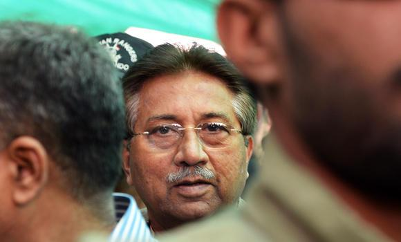 In this photograph taken on April 20, 2013, former Pakistani president Pervez Musharraf (C) is escorted by soldiers as he arrives at an anti-terrorism court in Islamabad.