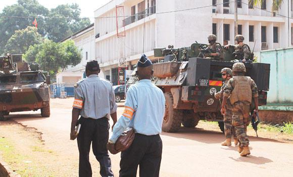 """French soldiers of the """"Sangaris Operation"""" secure the perimeter around a site where World Cup football matches will be broadcast, in Bangui, Central African Republic."""
