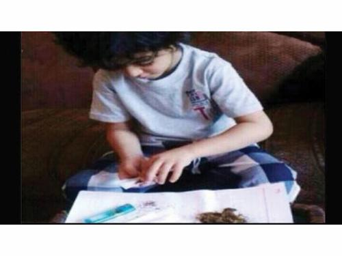 The boy rolling hashish cigarettes as seen in the video clip.