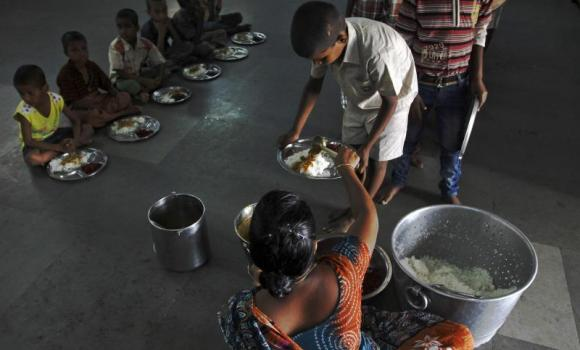 A boy receives food at an orphanage run by a non-governmental organization on World Hunger Day, in the southern Indian city of Chennai. (Reuters)