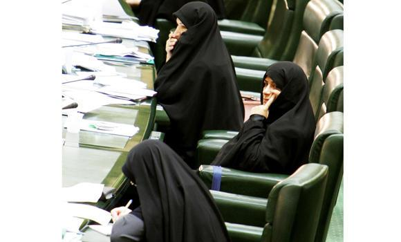Veiled Iranian women lawmakers attend an open session of parliament in this file photo.