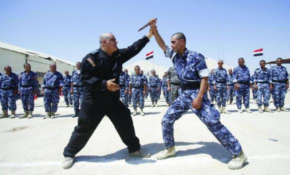 Newly-recruited Iraqi volunteers take part in a training session in Karbala.