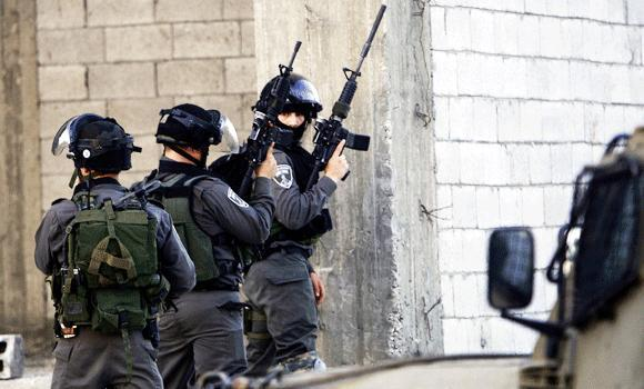 Israeli soldiers search for three missing teens believed to have been abducted in the West Bank city of Jenin, Thursday, June 19, 2014. Since the operation to locate the teens began a week ago, about 280 Palestinians have been arrested, the military said, including 200 members of Hamas.