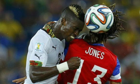 Ghana's John Boye jumps for the ball with Jermaine Jones of the US during their 2014 World Cup Group G soccer match at the Dunas arena in Natal on Monday.