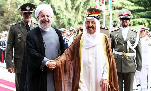 Iranian President Hassan Rouhani (C-L) greets Amir of Kuwait, Sheikh Sabah al-Ahmad al-Sabah (C-R) upon his arrival in Tehran on Sunday.