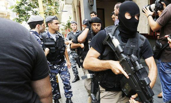 Members of the Lebanese security forces deploy during a raid on two hotels in Beirut's Hamra district, in this June 20, 2014 photo.