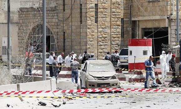 Lebanese security forces inspect the site of a suicide attack which targeted an army checkpoint on Friday, on the main highway from Beirut to Damascus in the Dahr al-Baidar area.