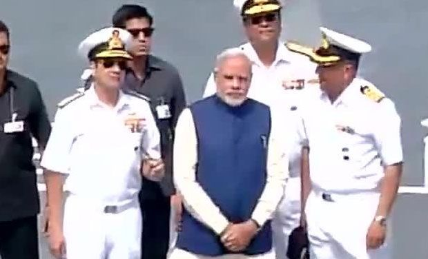 Indian Prime Minister Narendra Modi standing with senior Navy officers.