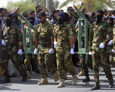 Mehdi Army fighters loyal to Shi'ite cleric Moqtada al-Sadr take part in a parade in Kerbala.
