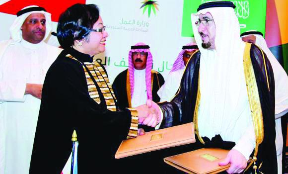 Labor Minister Rosalinda Dimapilis-Baldoz after the signing the landmark labor accord with Deputy Saudi Minister Mufarrej bin Saad Al-Haqbani.