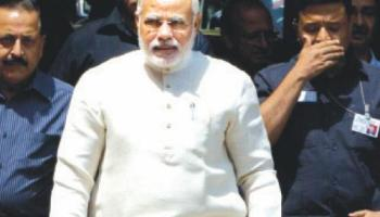 Indian Prime Minister Narendra Modi arrives at the Indian Parliament House in New Delhi on Wednesday.