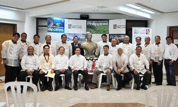 "Labor Attaché Rustico S.M. Dela Fuente, seated 4th from left, with fellow Filipinos who celebrated the birth of the late revolutionary Jose P. Rizal. With him are Emmanuel D. Mallari, Jr., 5th from left; Benny M. Quiambao, right; and Cenon ""Nonie"" C. Sagadal, standing 4th from left."