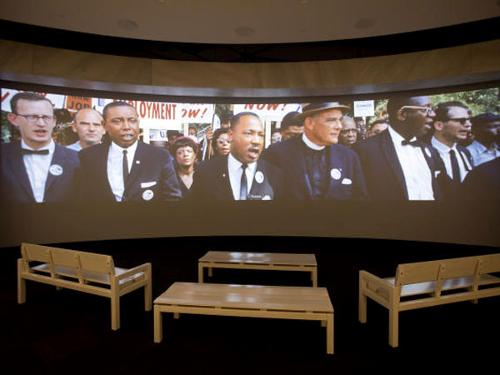 In this file photo, a movie plays as part of the March on Washington exhibit at the newly built National Center for Civil and Human Rights in Atlanta. The new museum about the history of civil rights opens next week in Atlanta, the city where Martin Luther King Jr. was based.