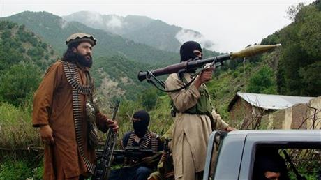 "In this file photo taken on Aug. 5, 2012, Pakistani Taliban patrol in their stronghold of Shawal in Pakistani tribal region of South Waziristan. The Pakistani army said it has launched a ""comprehensive operation"" against foreign and local militants in a tribal region near the Afghan border. An army statement issued Sunday, June 15, 2014 said the long-awaited offensive in North Waziristan was started at the direction of the government of Pakistan."