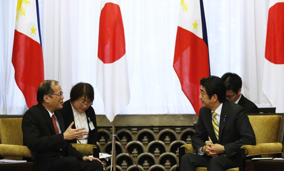 Philippine President Benigno Aquino meets with Japan's Prime Minister Shinzo Abe (R) at the prime minister's official residence in Tokyo on Tuesday. Aquino is in Japan for a one-day visit.