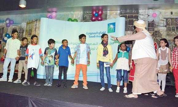 The children of Jeddah prisoners participating in a cultural program organized by Aramco at Shallal amusement park.