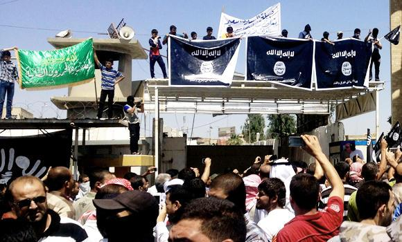 Demonstrators chant pro-al-Qaida-inspired Islamic State of Iraq and the Levant in front of the provincial government headquarters in Mosul, 225 miles (360 kilometers) northwest of Baghdad, Iraq.
