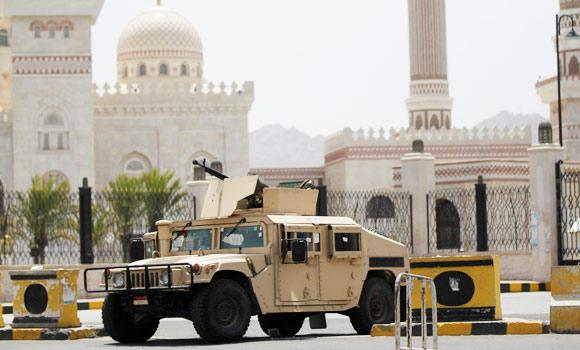 A military vehicle is stationed outside the al-Saleh mosque in Sanaa Monday.