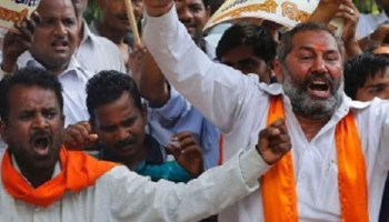 Shiv Sena workers protest against the alleged Facebook slights against their leaders in Pune.