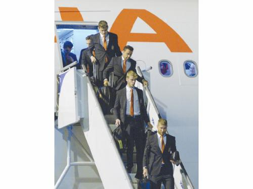 Members of the Spanish national team arrive at the international airport Alfonso Pena in Curitiba, Brazil, late Sunday