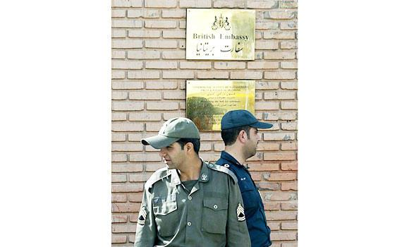 In this Oct. 7, 2005 file photo, Iranian soldiers stand guard in front of the gate of British embassy in Tehran.