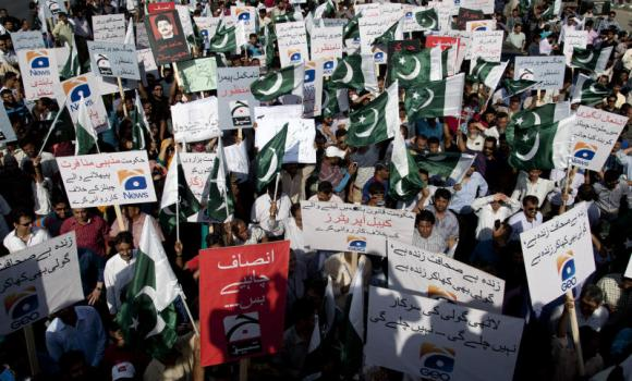 Employees of Pakistani Geo News TV channel hold a rally in Karachi.